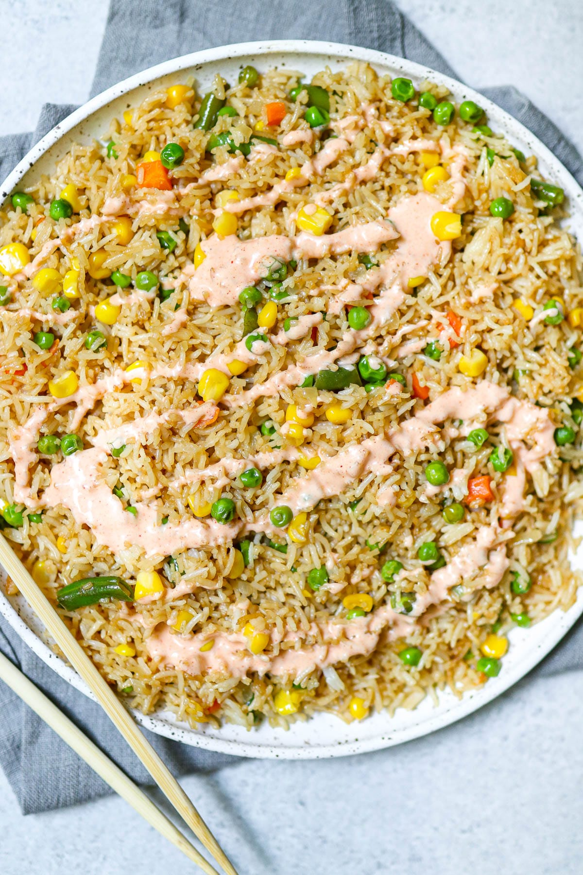 photo of cooked fried rice with sauce on top