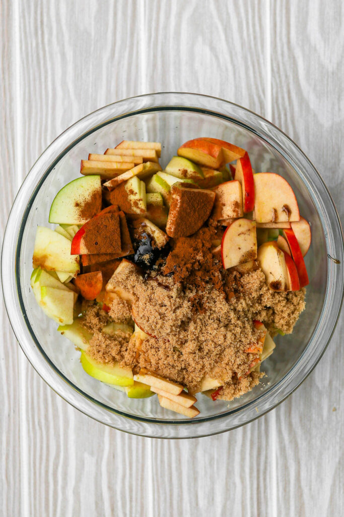 sliced apples with all mixture ingredients before mixing.