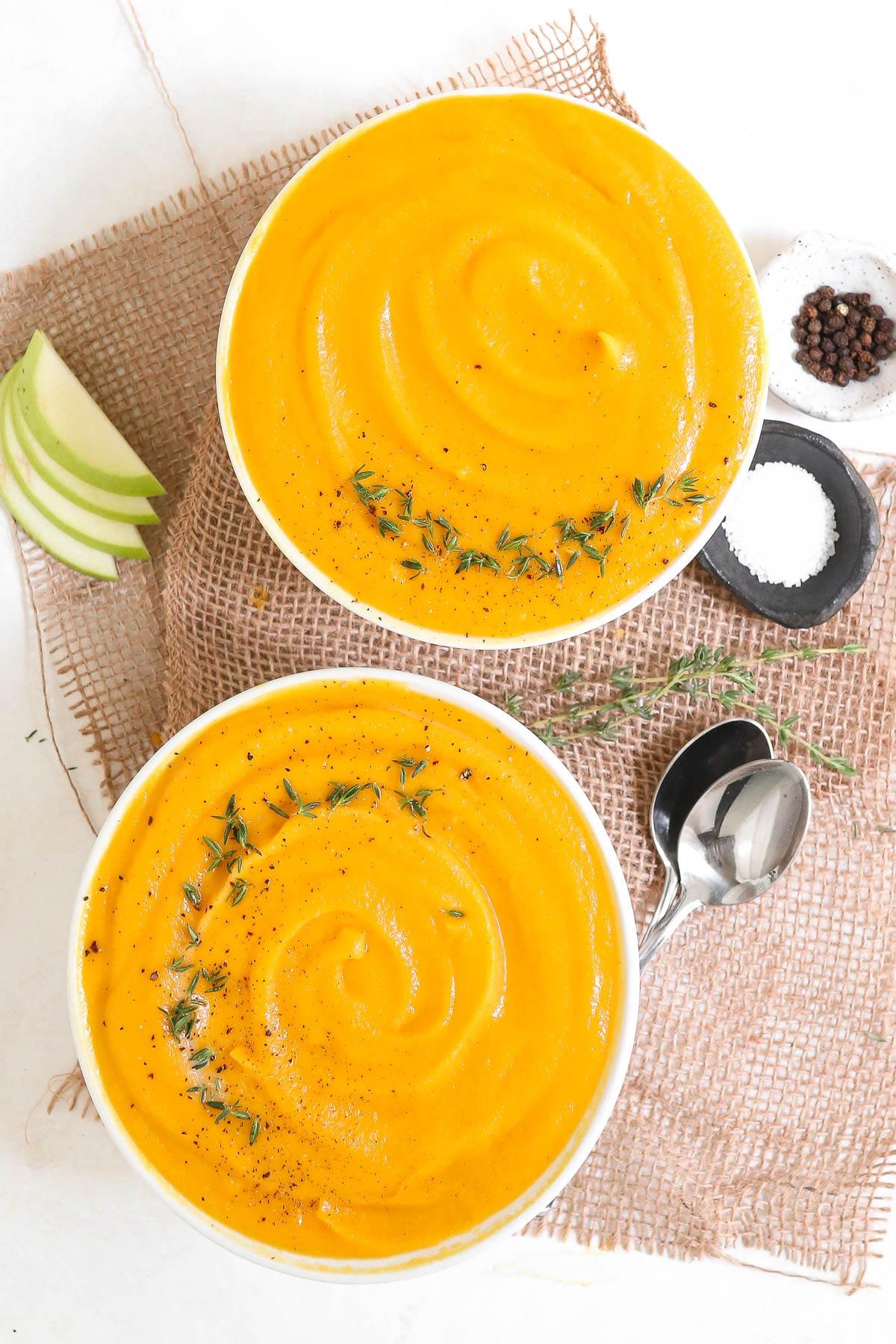 butternut squash soup in 2 bowls.