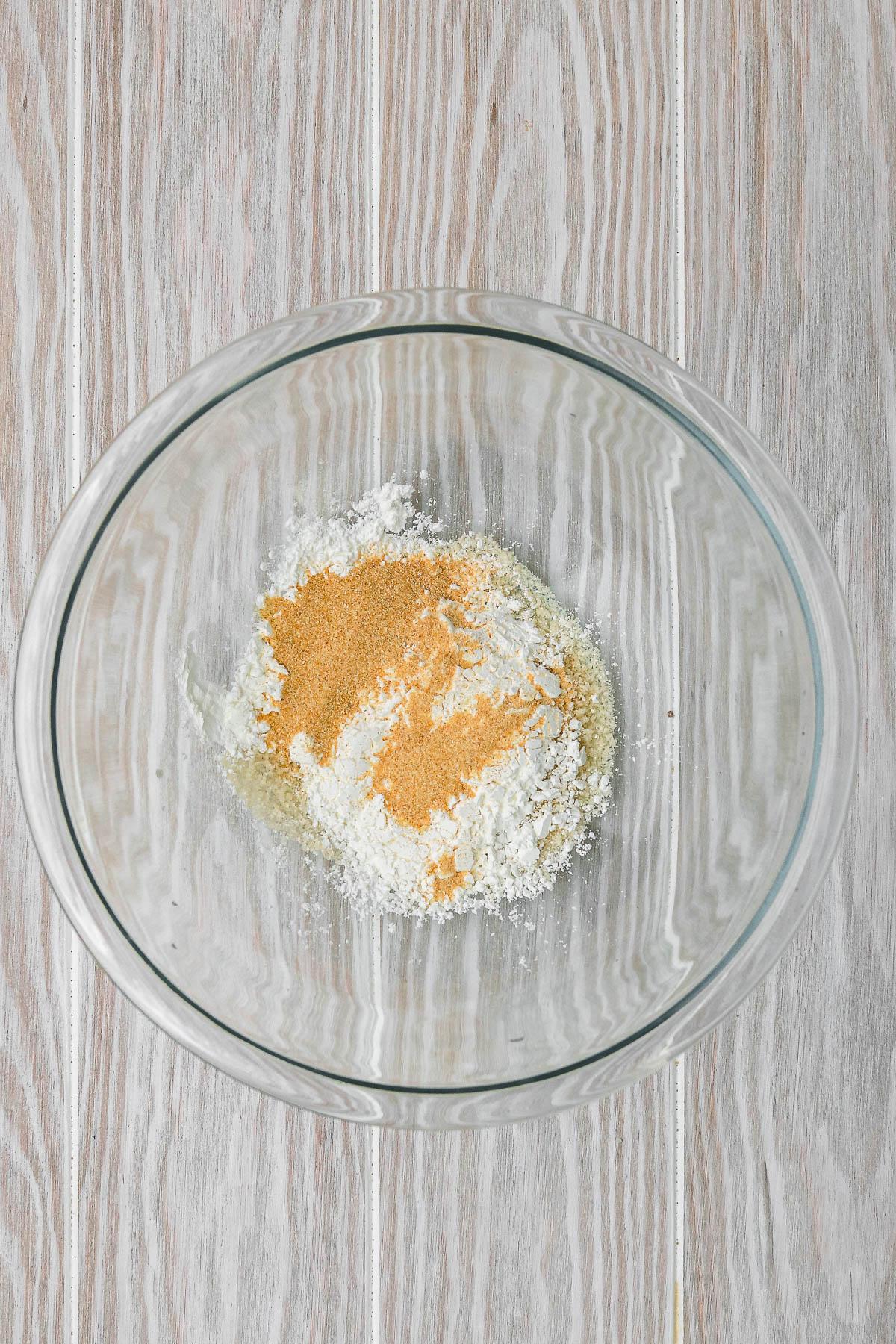 panko, cornstarch, and garlic powder in a glass bowl.