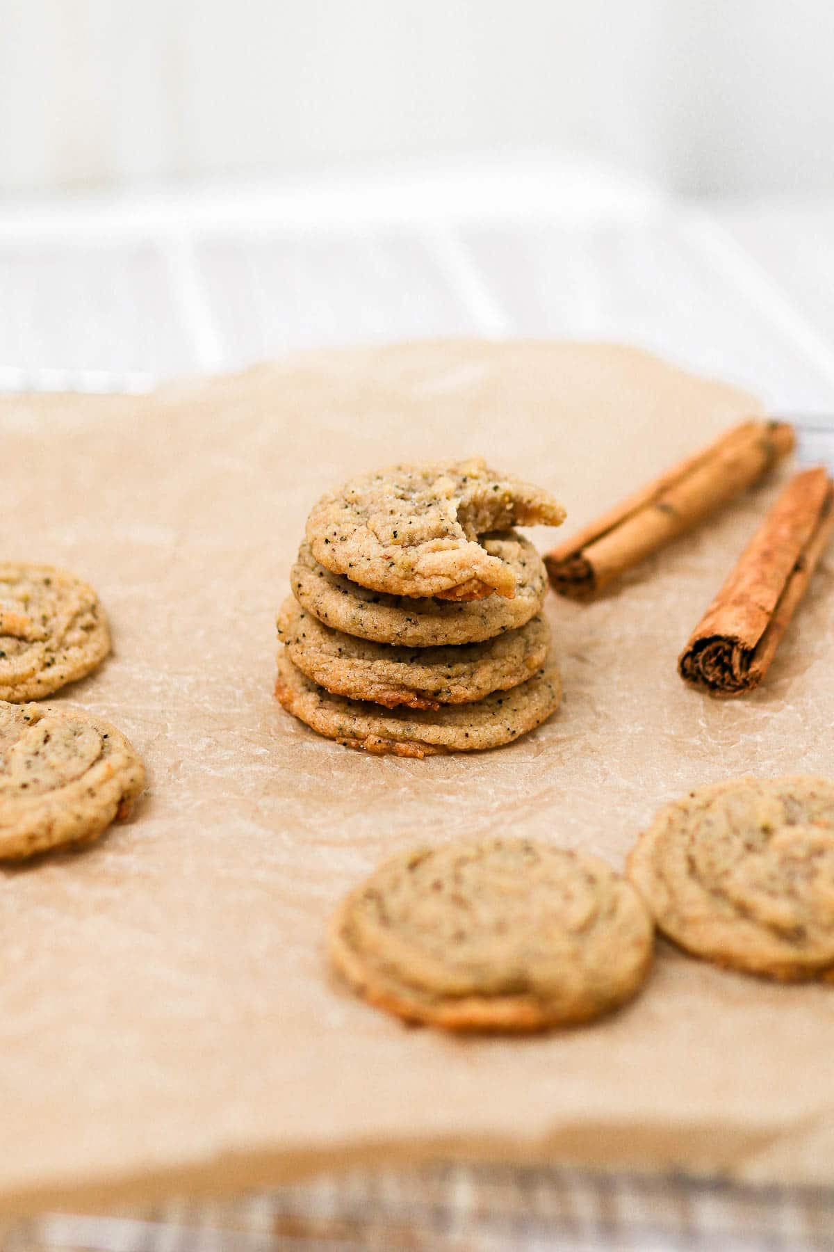stacked chai cookies on a cooling rack.